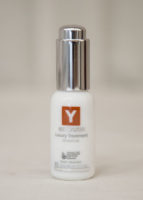 A bottle of Y natural's Luxury Treatment face oil that is used at Clarity Massage and Wellness for their organic facials