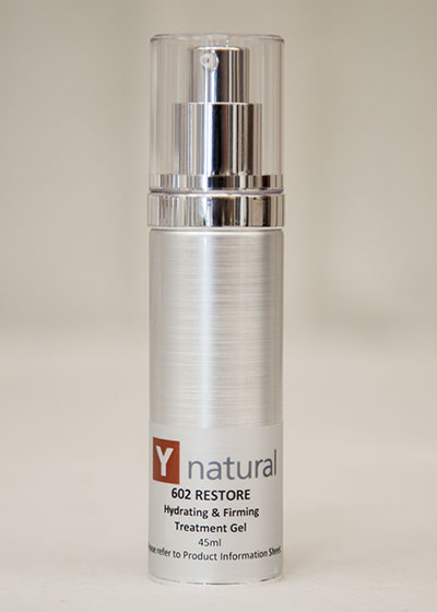 A bottle of Y natural's 602 Restore, hydrating and firming gel that is used at Clarity Massage and Wellness for their organic facials
