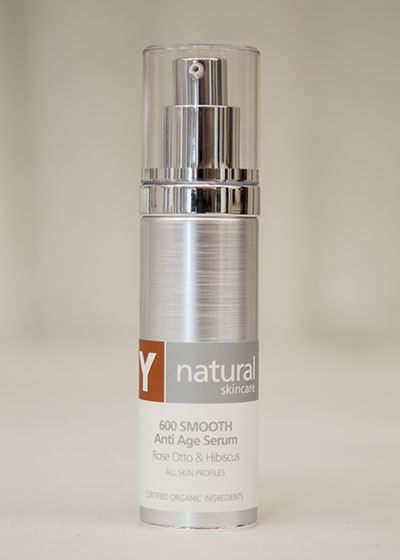 A bottle of Y natural's 600 Smooth, Anti Age Serum that is used at Clarity Massage and Wellness for their organic facials