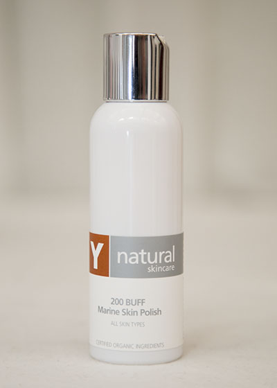 A bottle of Y natural's 200 Buff, a marine skin polish that is used at Clarity Massage and Wellness for their organic facials