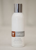 A bottle of Y natural's 101 Luxury, a cleansing lotion that is used at Clarity Massage and Wellness for their organic facials
