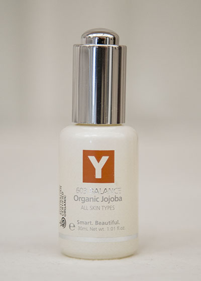 A bottle of Y natural's 603 Balance, an organic Jojoba that is used at Clarity Massage and Wellness for their organic facials