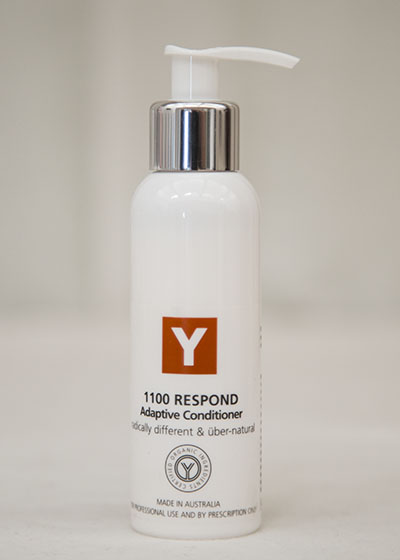 A bottle of Y natural's 1100 Respond, an adaptive conditioner that is used at Clarity Massage and Wellness for their organic facials