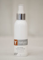 A bottle of Y natural's 403 Refine, a Melaleuca & Nettle skin conditioner that is used at Clarity Massage and Wellness for their organic facials