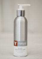A bottle of Y natural's 700 Soft, a hand and body lotion that is used at Clarity Massage and Wellness for their organic facials