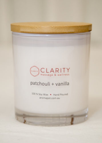 Hand-poured soy candle sold at Clarity Massage and Wellness